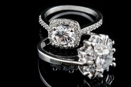 Luxury jewellery. White gold or silver engagement rings with diamonds closeup. Selective focus